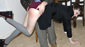 Elle spanked before her caning punishment