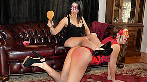 Joelle receives an embarrassing wooden paddle punishment from Sarah Gregory
