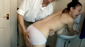 Spanked over wet panties